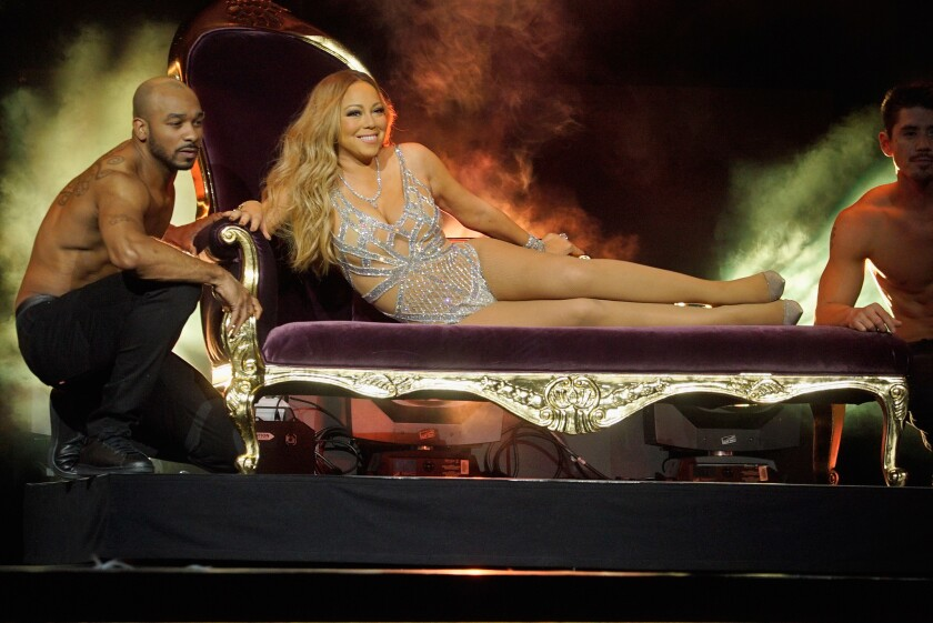 """At NBCUniversal's upfront presentation to media buyers, Mariah Carey, promoting her """"Mariah's World"""" reality show on E!, is delivered to the stage by shirtless helpers."""