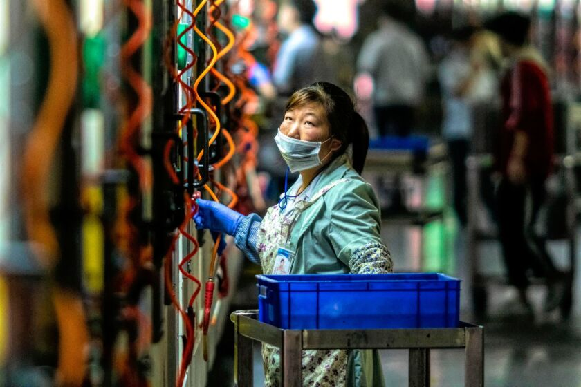 A worker at the Everwin precision technology factory in Dongguan, in China's Guangdong province.