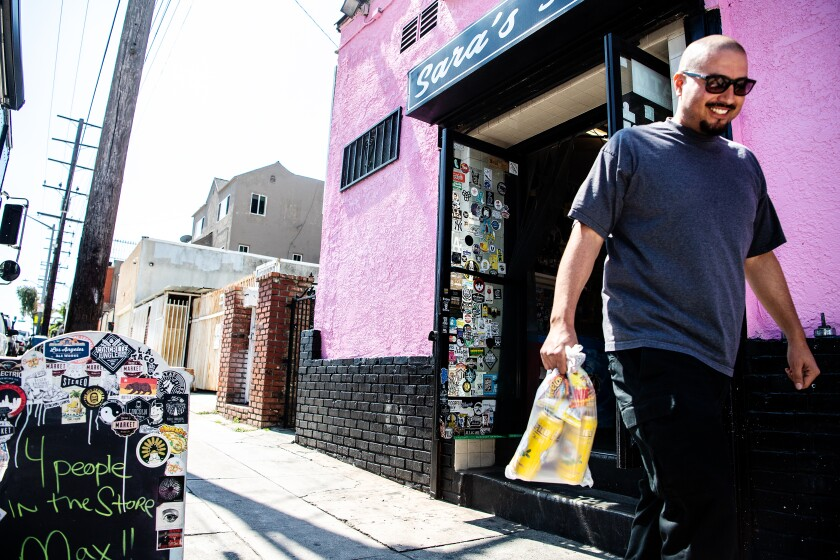 Satisfied with his purchases, longtime customer David Ramirez leaves Sara's Market.