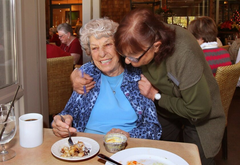 Long time Lawrence Welk resort employee Adriene Edwards, at right, greets 98 year old Callie Zurcher as she dines at the Canyon Grille Restaurant at the Welk resort. Callie has been a regular at the restaurant since 1998. Adriene has worked at the resort for nearly 50 years.