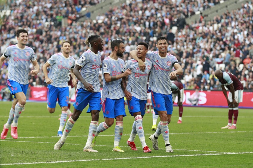 Manchester United's Jesse Lindgard, second left, reacts with teammates after scoring his side's second goal during the English Premier League soccer match between West Ham United and Manchester United at the London Stadium in London, England, Sunday, Sept. 19, 2021. (AP Photo/Ian Walton)