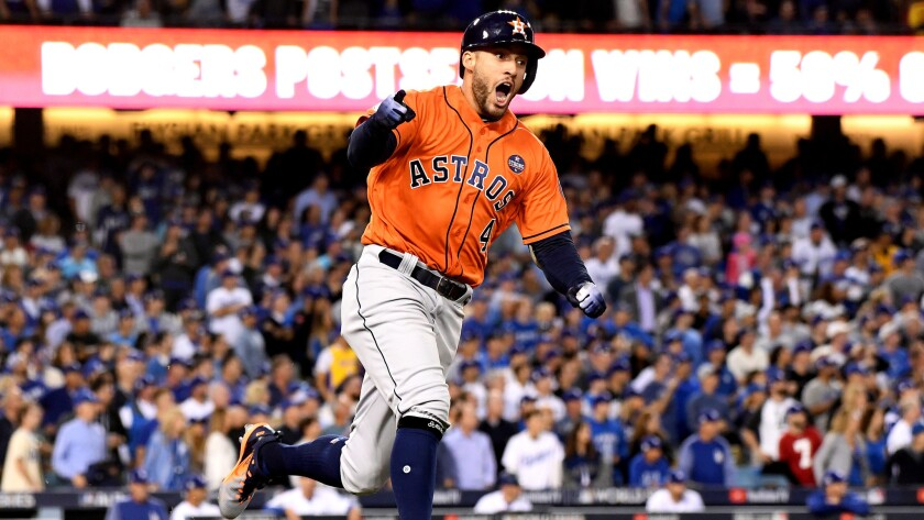 Astros center fielder George Springer celebrates as he rounds first base after hitting a two-run homer against the Dodgers during the second inning of Game 7.