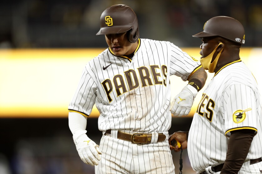 The San Diego Padres' Manny Machado grimaces as he stands on first base