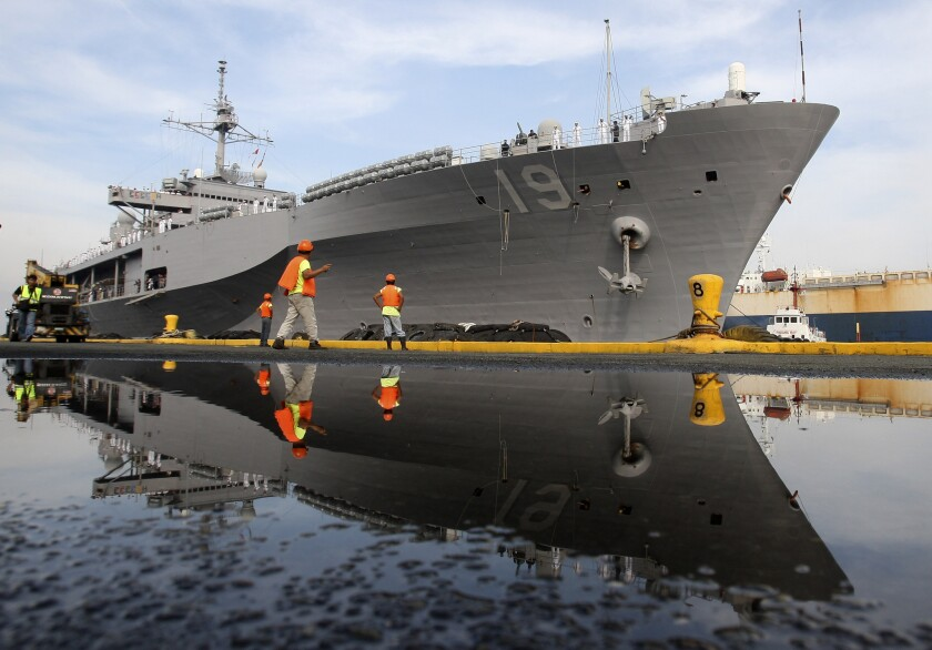 The battleship Blue Ridge, the flagship of the U.S. Navy's 7th Fleet, docks at Manila South Harbor in the Philippines.