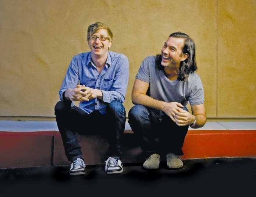 "Kyle Jarrow (left) and Duncan Sheik are collaborators  on ""Whisper House."""