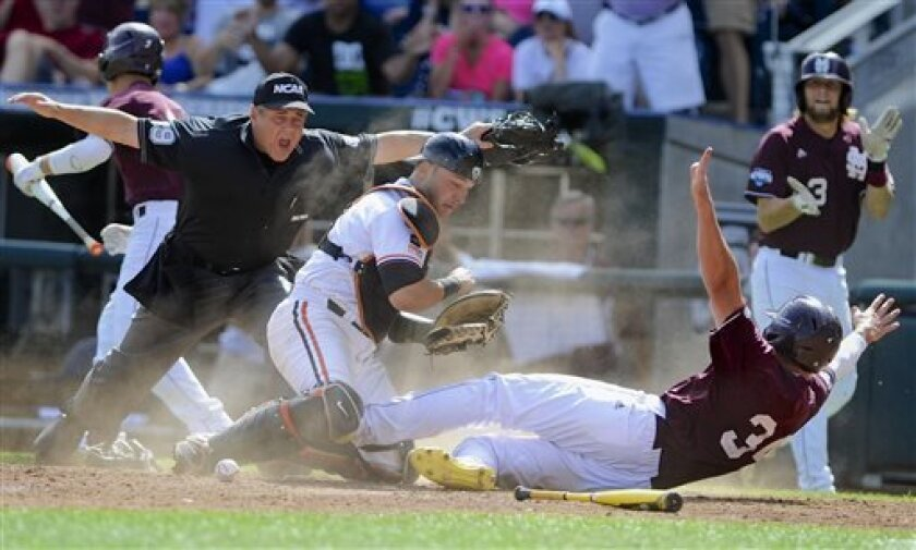 Mississippi State's Hunter Renfroe (34) scores under Oregon State catcher Jake Rodriguez in the eighth inning of the opening game of the NCAA College World Series, in Omaha, Neb., Saturday, June 15, 2013. Renfroe scored on an RBI double by Wes Rea. (AP Photo/Eric Francis)