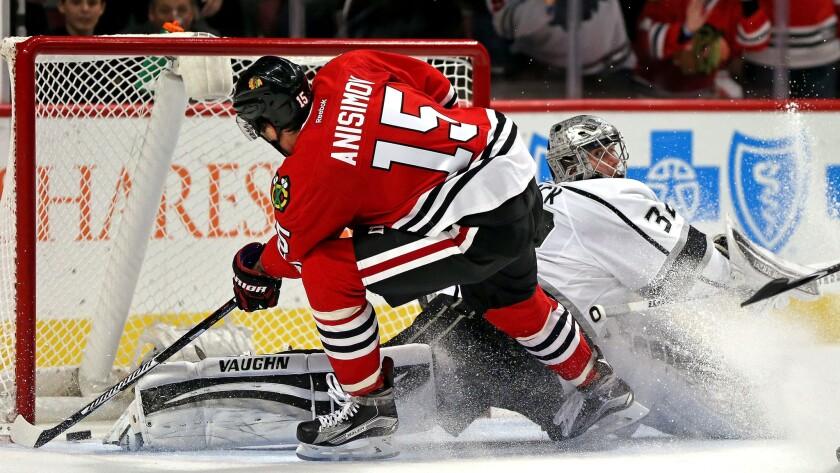 Blackhawks center Artem Anisimov slips the puck past Kings goaltender Jonathan Quick during a game Nov. 2 in Chicago.
