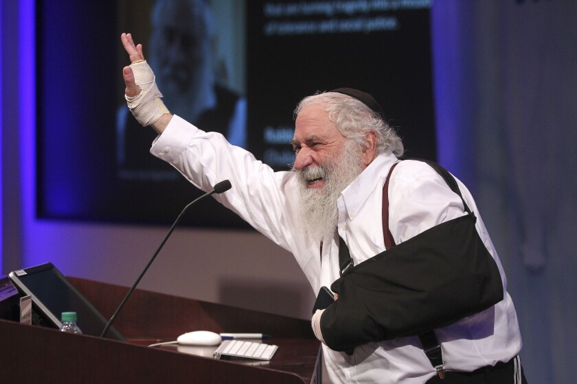 "Rabbi Yisroel Goldstein of Chabad of Poway gave opening remarks during the ""Confronting Hate, Bigotry, Ignorance ...a Path Forward"" event at University of San Diego on Wednesday."
