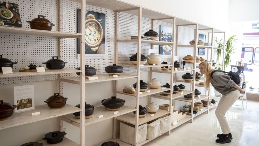 A customer browses the selection of earthenware donabe pots on display at Toiro in West Hollywood.