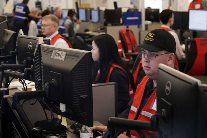 In October 2019, PG&E employees work at the utility's emergency operations center in San Francisco.