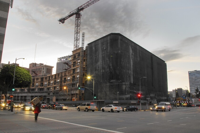 An apartment project under construction in downtown Los Angeles this year. On Tuesday, voters approved Measure JJJ, which imposes new affordable housing requirements on L.A. developments.