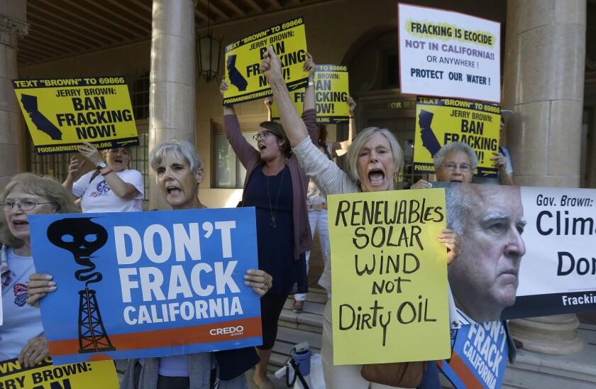 Demonstrators protest against Gov. Jerry Brown's support for fracking.
