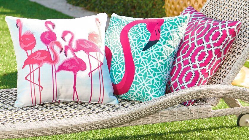 Grandin Road's Pretty in Pink Outdoor Pillow Collection celebrates the serendipity of a kitsch symbol of '50s Floridiana. Grandin Road photo