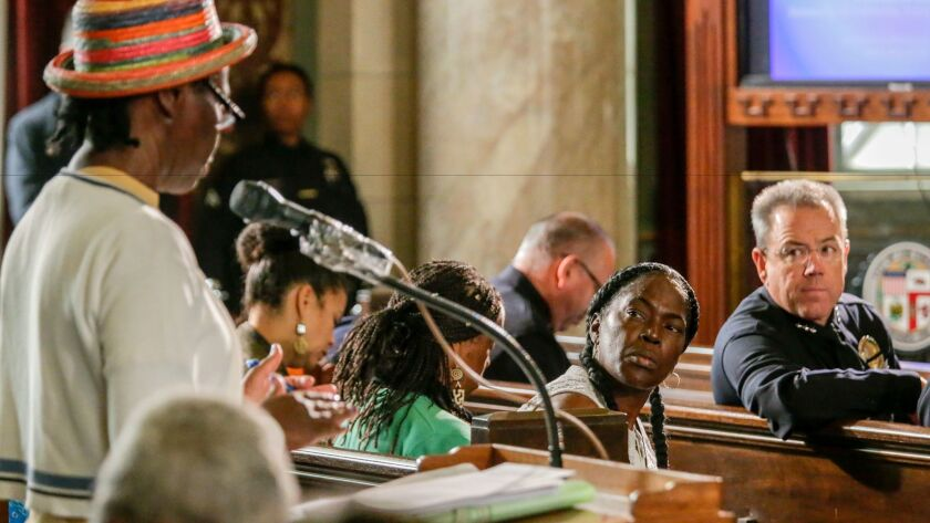 A speaker addresses the Los Angeles Police Commission on the subject of allegations of racial profiling by officers on Nov. 12.