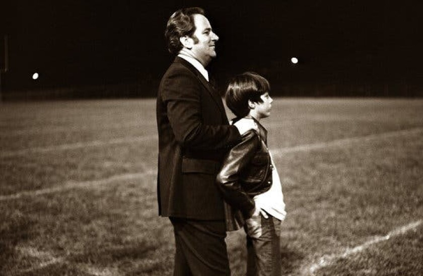 Jerry Fallwell Sr. and Jerry Falwell Jr. attend one of the first Liberty University games together in the 1970s.