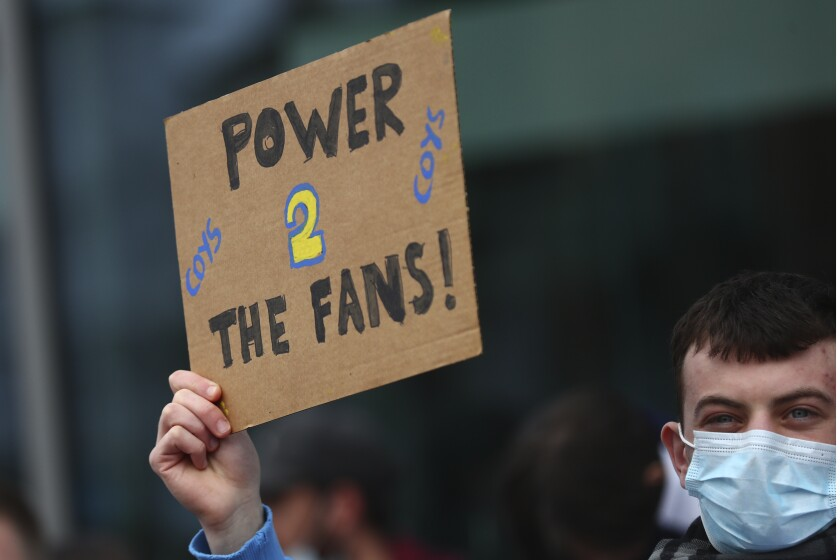 A Tottenham fan takes part in a protest against the Board over the planned creation of a European Super League, outside the Tottenham Hotspur Stadium ahead of the English Premier League football match between Tottenham Hotspur and Southampton in London, England, Wednesday April 21, 2021. (Clive Rose/Pool via AP)