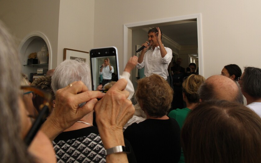 Presidential candidate Beto O'Rourke speaks at a house party in Bedford, N.H.
