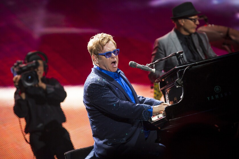 """""""I have a great relationship with my husband, I have two wonderful children — you know, I'm pretty damn lucky,"""" Elton John says."""
