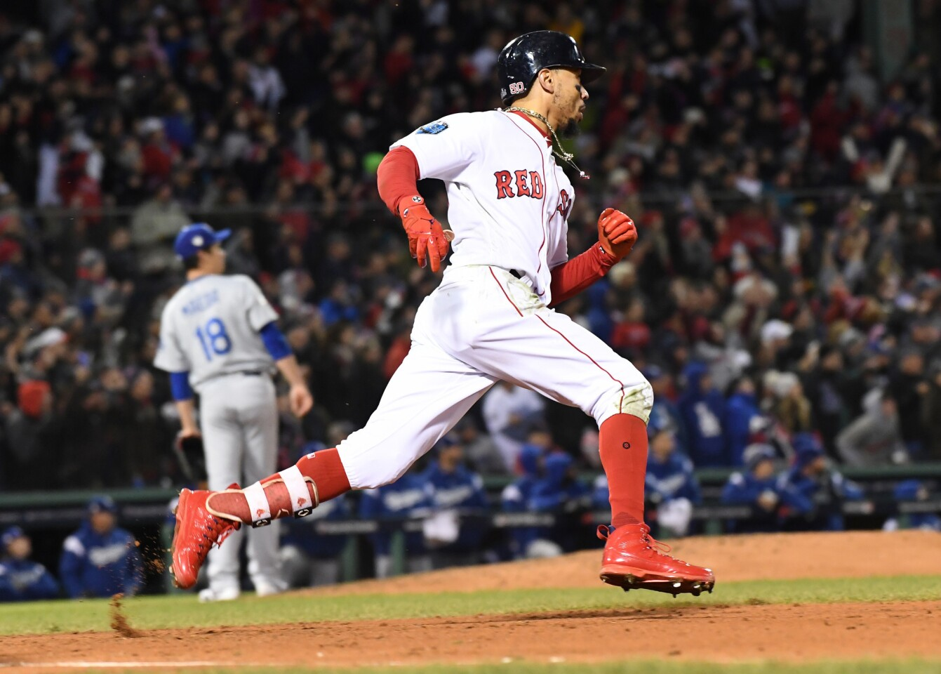 Red Sox's Mookie Betts scores a run in the fifth inning of game two of the World Series against the Dodgers at Fenway Park.