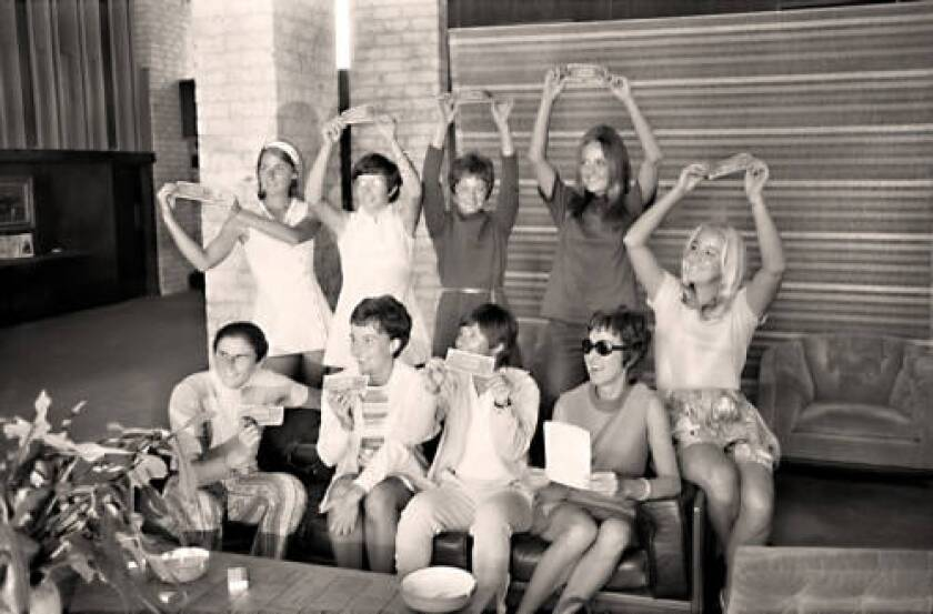 """The """"Original 9"""" women's tennis players pose with dollar bills Sept. 23, 1970, at the Houston Racquet Club."""
