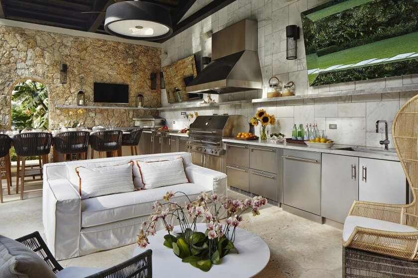 Outdoor kitchens are as well-equipped now as their indoor counterparts.