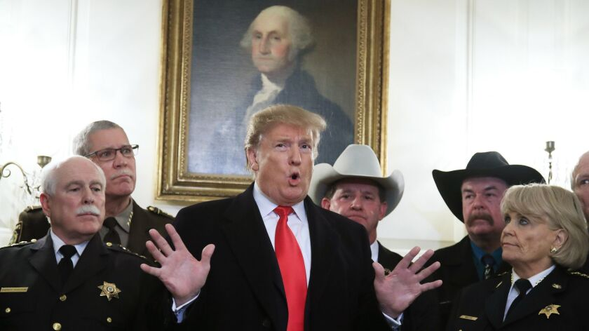 President Trump speaks during a meeting with a group of sheriffs from around the country before leaving the White House in Washington for a trip to El Paso, Texas on Feb. 11.