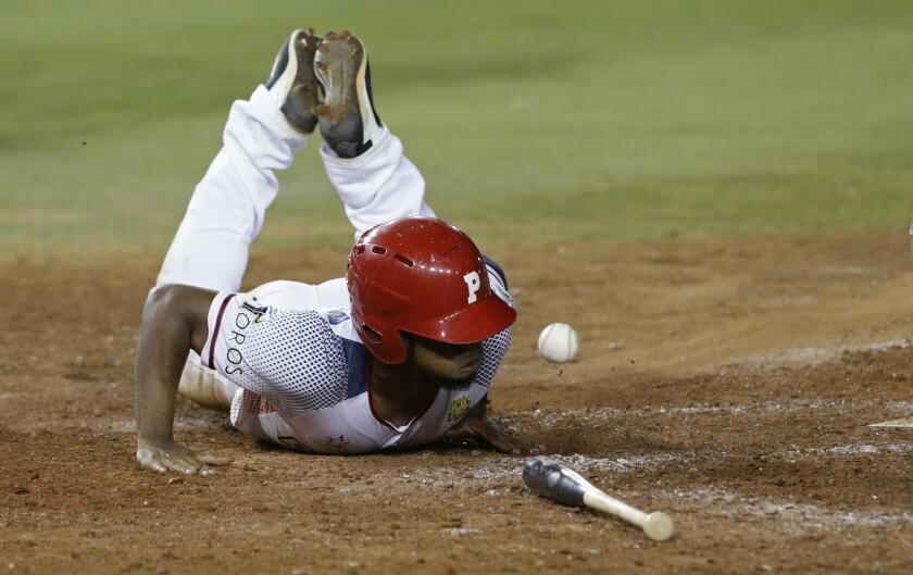 Rodrigo Orozco of Panama's Los Toros de Herrera slides home in the seventh inning against Dominican Republic's Estrellas Orientales during the Caribbean Series baseball tournament at Rod Carew stadium in Panama City, Tuesday, Feb. 5, 2019.