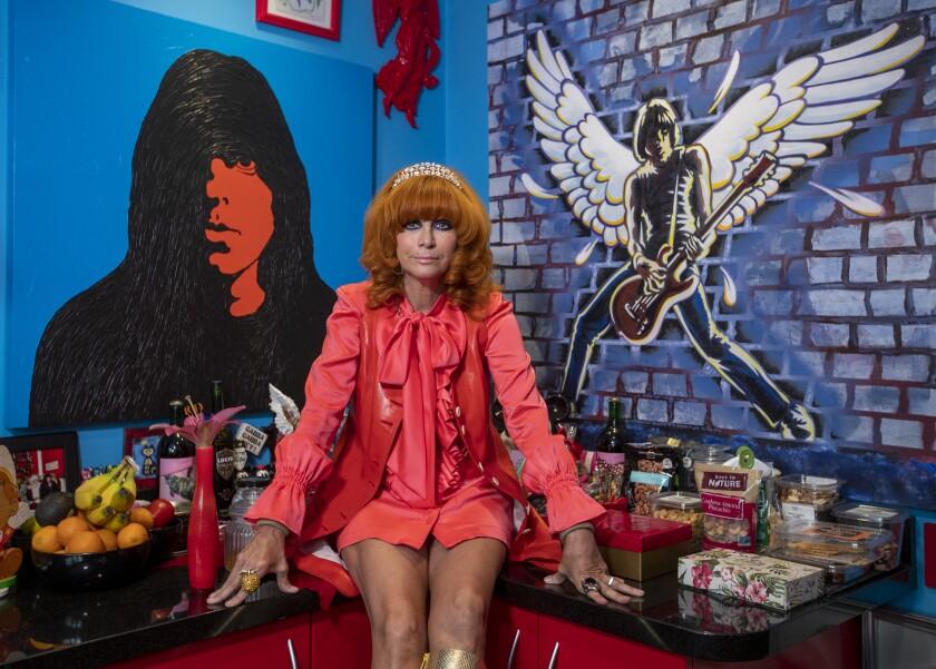 Linda Ramone, widow of Ramones songwriter-guitarist Johnny Ramone, poses on the kitchen counter of her home.