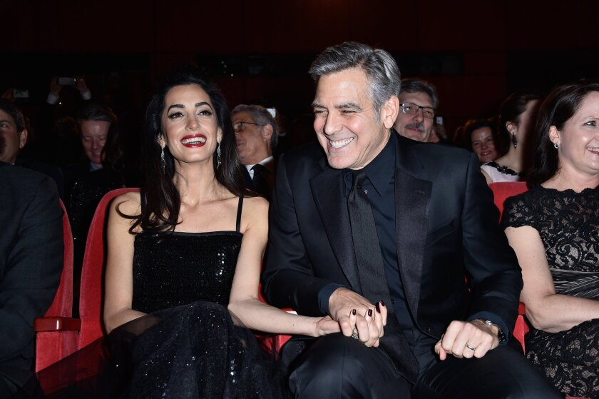 """Actor George Clooney and his wife, Amal Clooney, attend the """"Hail, Caesar!"""" premiere during the 66th Berlinale International Film Festival at Berlinale Palace on Thursday."""