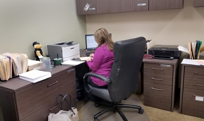 Martin County Sheriff John Kirk's wife Regina does payroll one evening. She has a fulltime job elsew