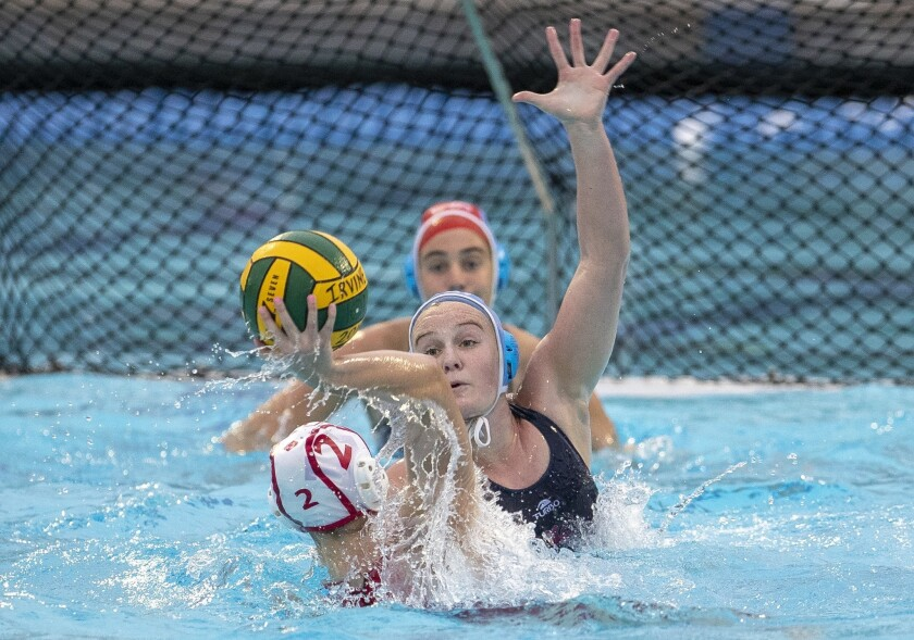Corona del Mar's Sophie Wallace attempts to block a shot by Orange Lutheran's Delaney Demsher during