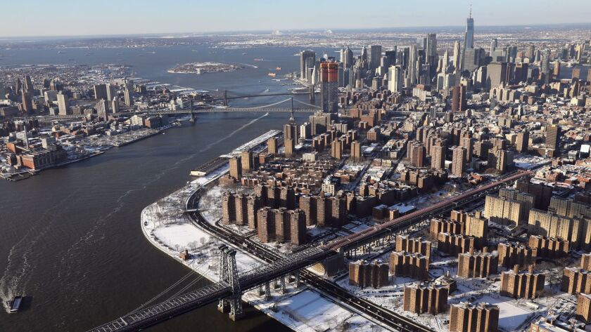 The toll-free Williamsburg Bridge stretches across the East River into Manhattan.