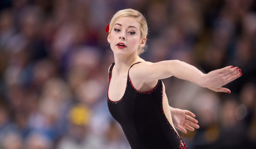 American Gracie Gold was in first place after the women's short program at the figure skating world championships in Boston on March 31, 2016.