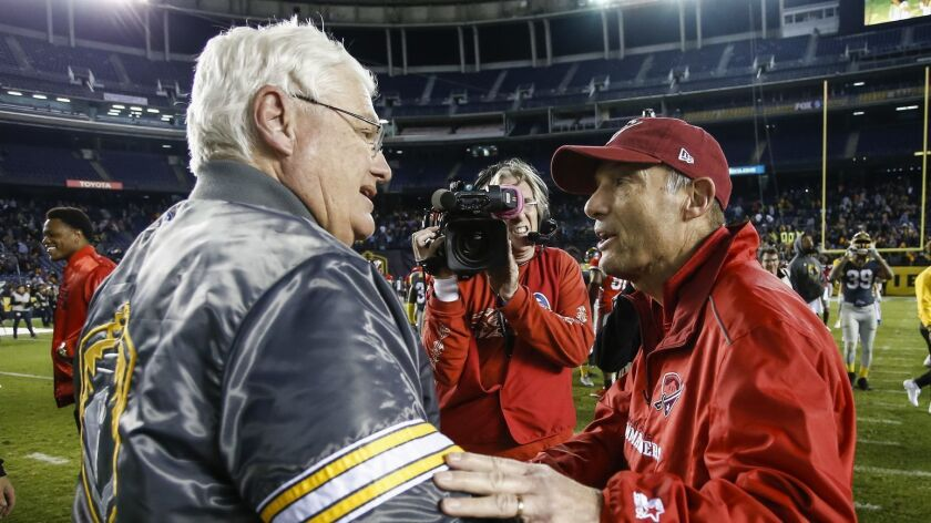 Fleet head coach Mike Martz and San Antonio Commanders head coach Mike Riley shake hands after the Fleet's 31-11 victory Sunday at SDCCU Stadium.