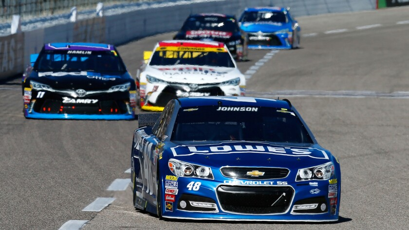 NASCAR driver Jimmie Johnson leads the pack during the Sprint Cup Series race Sunday at Texas Motor Speedway.