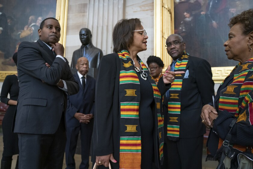 In this Oct. 24, 2019, file photo members of the Congressional Black Caucus gather for a memorial ceremony for the late Maryland Rep. Elijah Cummings at the Capitol in Washington. From left are Rep. Joe Neguse, D-Colo., Rep. John Lewis, D-Ga., Rep. Robin Kelly, D-Ill., Rep. Gwen Moore, D-Wis., Rep. Gregory Meeks, D-N.Y., and Rep. Barbara Lee, D-Calif. The Congressional Black Caucus PAC is endorsing Joe Biden's presidential bid, further cementing his support among the nation's influential black political leadership. (AP Photo/J. Scott Applewhite, File)