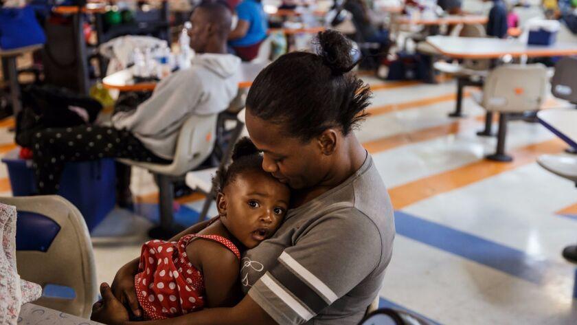 Shekeisha January and her daughter Genesis January, 2, cuddle at Max Bowl.