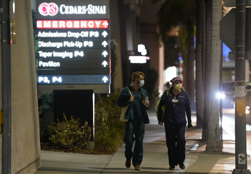FILE - In this Jan. 5, 2021, file photo, Cedars-Sinai Medical Center workers walk outside the hospital, in Los Angeles. The California Senate has rejected a bill aimed at making it easier for some hospital workers to get workers compensation benefits. (AP Photo/Chris Pizzello,File)