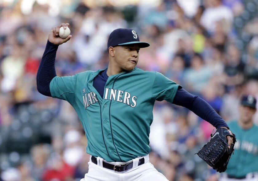 Seattle Mariners starting pitcher Taijuan Walker throws against the Cleveland Indians during the first inning of a baseball game Friday, May 29, 2015, in Seattle. (AP Photo/Elaine Thompson)
