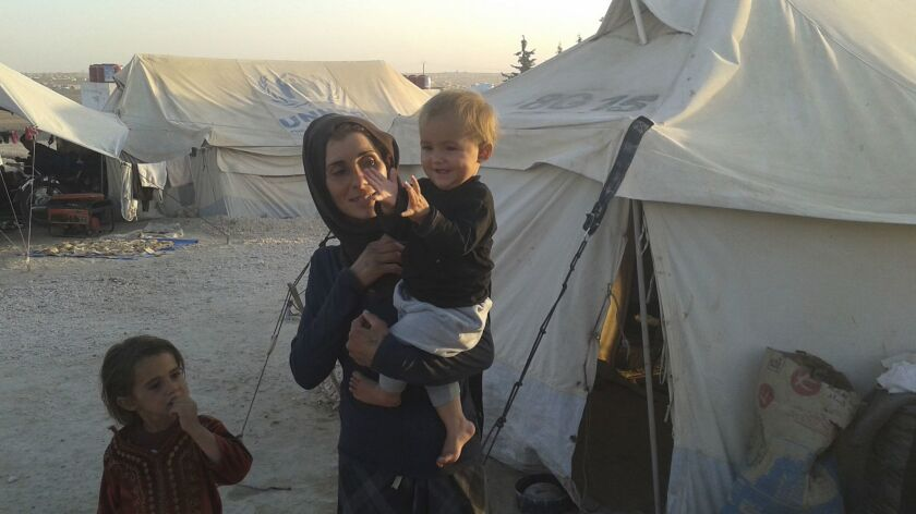 Watha Haider can't afford to rebuild her destroyed home in Raqqah, Syria. Her family spent all the