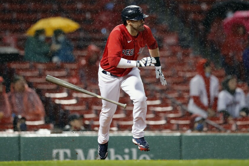 Boston Red Sox's J.D. Martinez runs on his two-run double during the third inning of a baseball game against the Miami Marlins, Friday, May 28, 2021, in Boston. (AP Photo/Michael Dwyer)