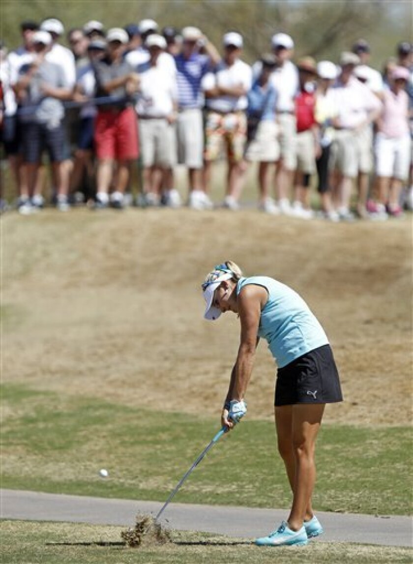Lexi Thompson hits her approach shot off the eighth fairway during the first round of the Founders Cup golf tournament on Thursday, March 14, 2013, in Scottsdale, Ariz. (AP Photo/Paul Connors)