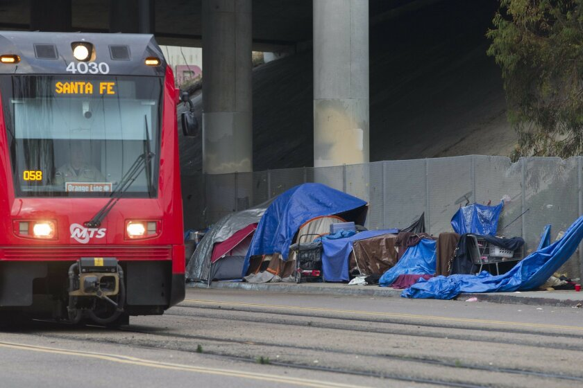 Homelessness is on the rise in San Diego according to recent studies. Homeless people along Commercial Street Downtown set up makeshift tents before the sun sets Wednesday night.