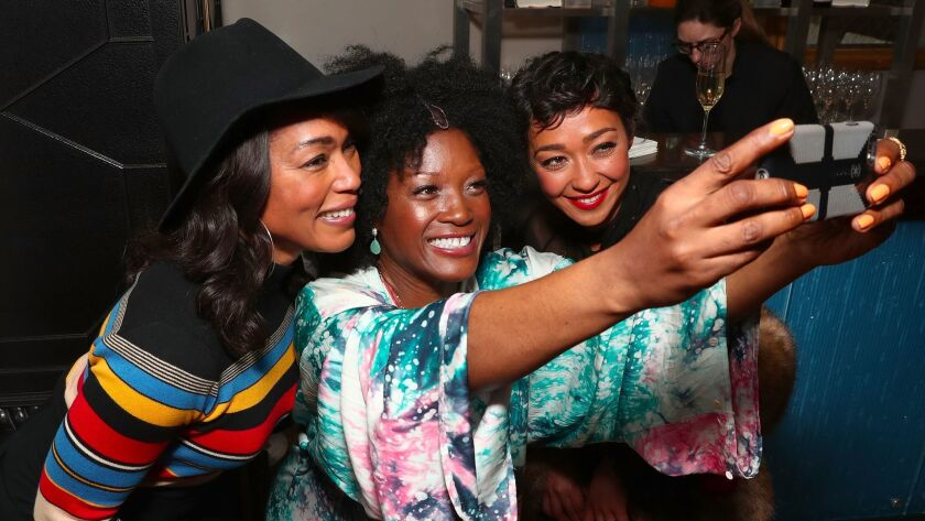 Angela Bassett, Yolanda Ross and Ruth Negga take a selfie.