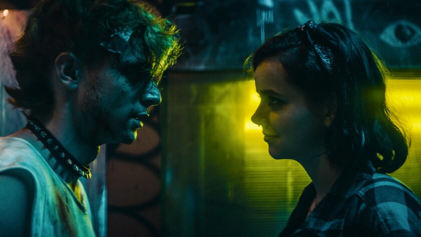 "(L-R) Dave Davis as Brian and Maemae Renfrow as Jade in the crime, drama film ""BOMB CITY"" a Gravitas"