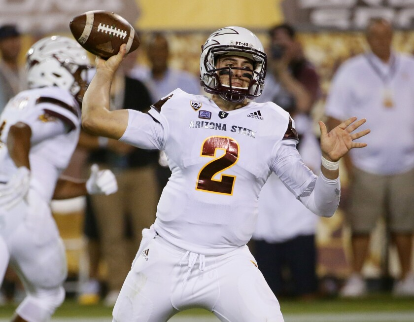 Arizona State quarterback Mike Bercovici throws a first half pass against New Mexico.