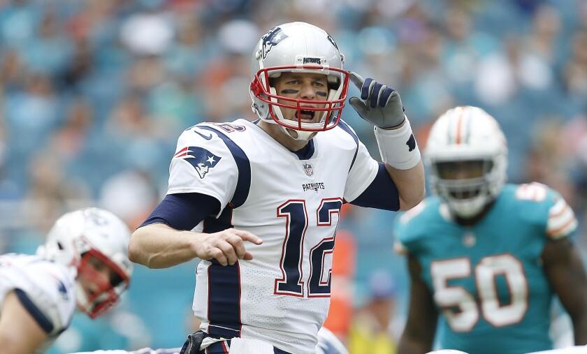 New England Patriots quarterback Tom Brady calls out a play.