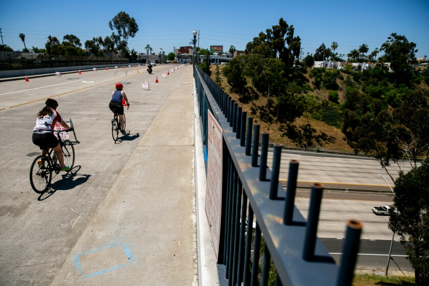 Cyclists on a 'slow street' Normal Heights in May. The city eliminated the segment this week in response to complaints.