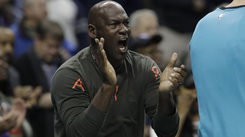 Charlotte Hornets owner Michael Jordan reacts to a play by his team against the Detroit Pistons duri