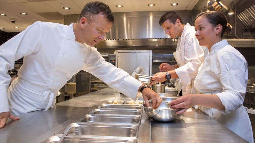 Chef William Bradley, left, works with some of his assistants in the afternoon at the Addison at the Fairmont Del Mar Resort as they prepare for dinner. At right is Stefani De Palma. In the background is Dusan Todic.